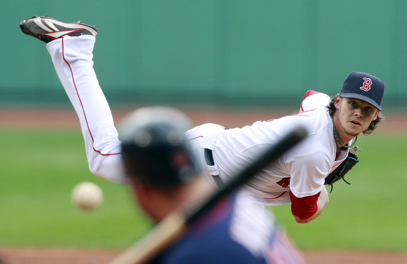Clay Buchholz pitches during the first inning of Saturday's game with Minnesota in Boston. Buchholz pitched two innings, then waited out a rain delay of more than two hours before pitching three more innings in a 4-0 Sox win.