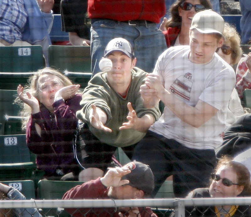 A fan unsuccessfully tries to catch a foul ball during Sunday's game at Hadlock Field between the Portland Sea Dogs and New Britain Rock Cats. The Sea Dogs fell to 3-5 this season against New Britain.