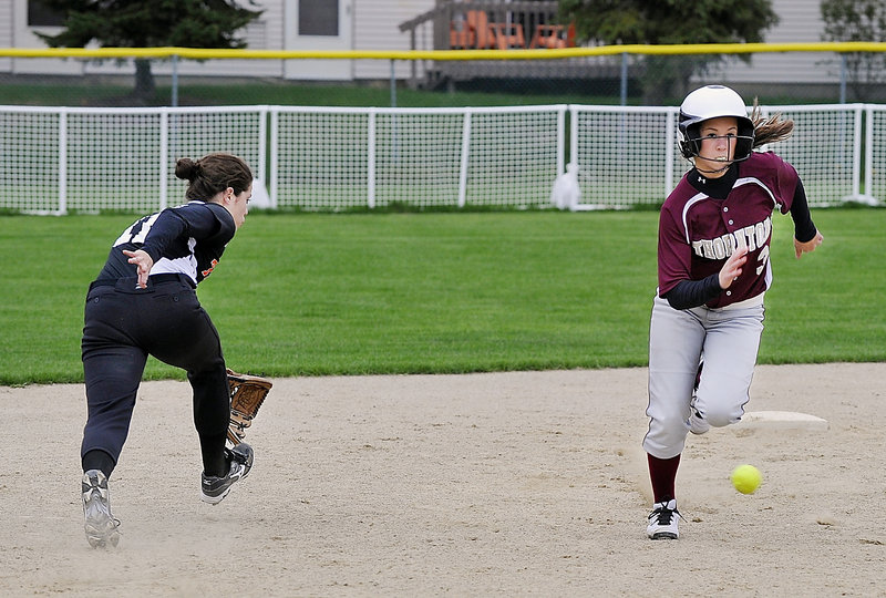 Thornton's Morgan Dube runs past a hit by teammate Kristen Duross on her way to score the winning run on Monday afternoon.