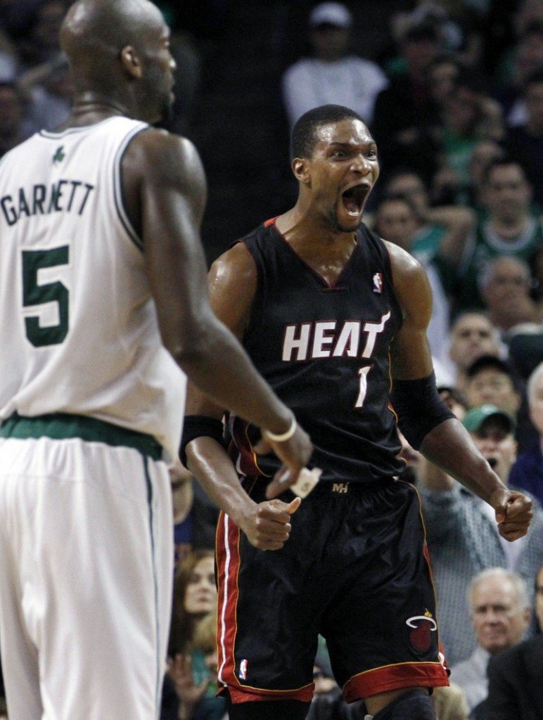 There's no wondering how Miami's Chris Bosh feels as the Heat take command late in overtime Monday night in Boston. Bosh scored 20 points for the Heat.