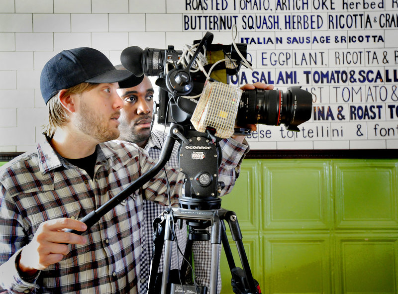 """A film crew from No Regrets Entertainment – videographer Seth Marshall and producer Rasheed J. Daniel – frames a shot at the Otto pizza shop in Portland on Tuesday for a show called """"Pizza Outside the Box,"""" to be aired on the Cooking Channel on Aug. 7."""