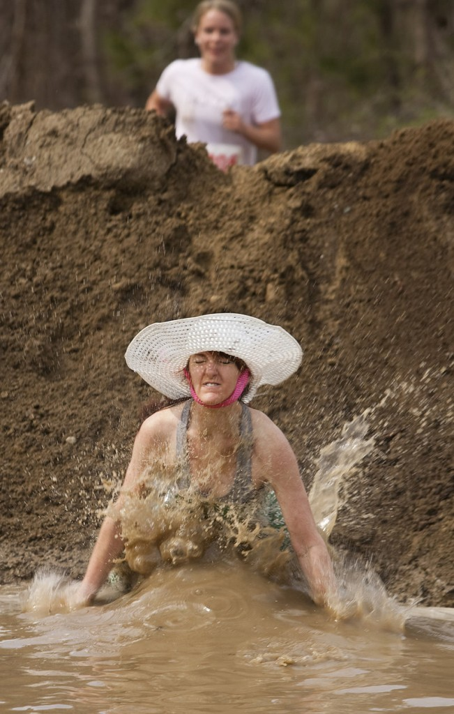 Allison Caney plunges into the mud near Gorham Middle School during last weekend's Mud Run.
