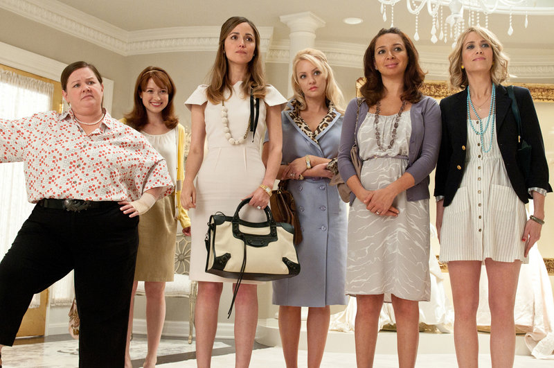 """In """"Bridesmaids,"""" from left, Melissa McCarthy, Ellie Kemper, Rose Byrne, Wendi McLendon-Covey, Maya Rudolph and Kristen Wiig make wedding rituals funny."""