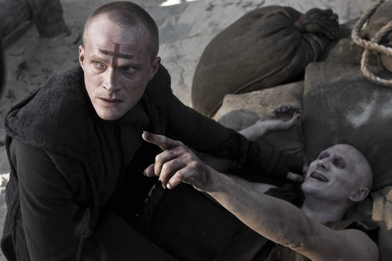 Priest (Paul Bettany) finishes off Familiar #1 (Josh Wingate) in the new sci-fi action thriller
