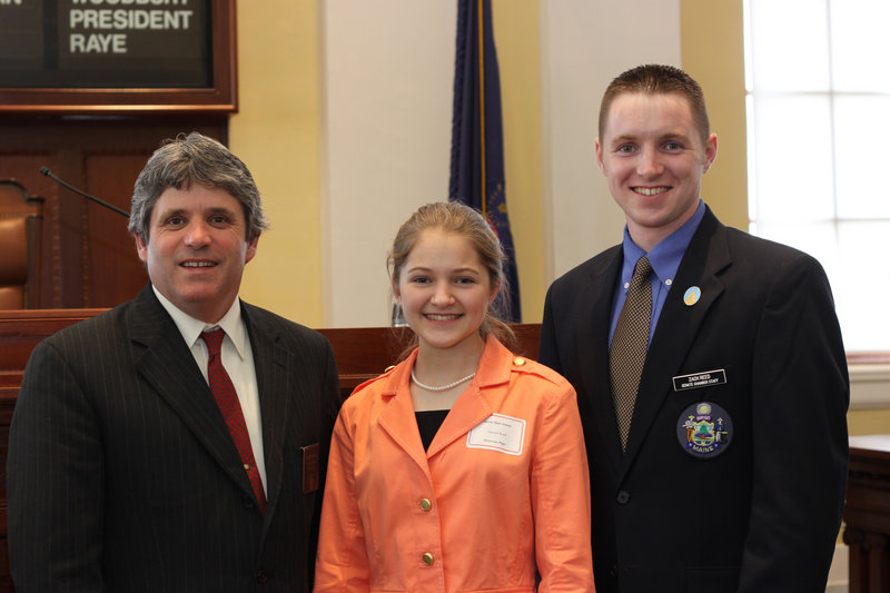 Hannah Reed, a 15-year-old home-schooled student from Nobleboro, recently served as an honorary page in the Maine Senate. She is seen in the well of the Senate with state Sen. David Trahan, R-Waldoboro, left, and her brother Zachary Reed, right, who is a member of the Maine Senate Chamber staff.