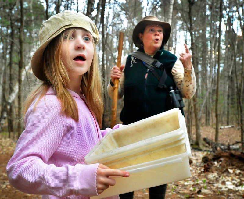 Adeline Runnels of Auburn pays attention as trip leader Susan Hayward points out the call of a barred owl.
