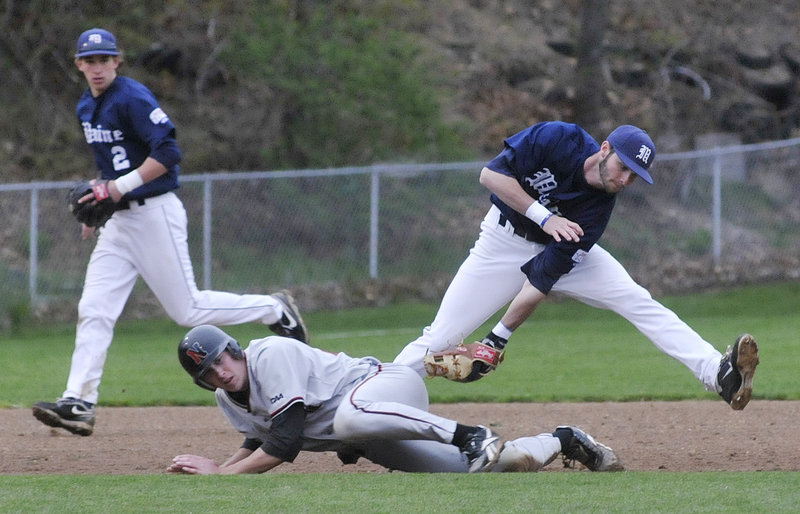 Maine third baseman Mike Connolly manages to tag out Northeastern's Tucker Roeder, who dives in an attempt to avoid it. Maine upped its winning streak to eight games by rallying in the ninth inning for a 5-2 victory Tuesday night at Goodall Park in Sanford.