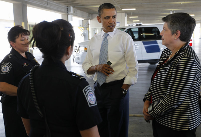 President Obama and Homeland Security Secretary Janet Napolitano tour a cargo facility in El Paso, Texas, on Tuesday, during their visit to the U.S.-Mexico border.