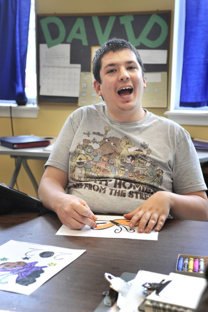 David Bouchard greets visitors to his classroom at the Morrison Center. In 2007, an autistic high school graduate in Maine could easily transition into publicly funded adult services, but today, waiting lists are long.