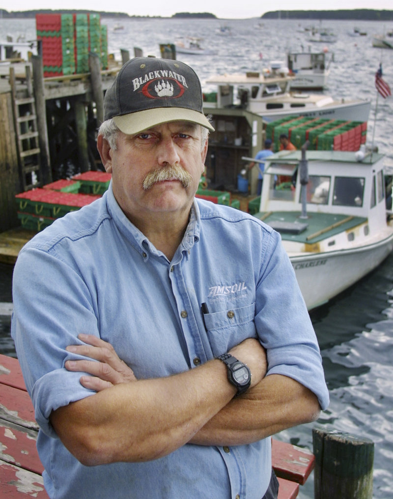 "Lobsterman and former Navy underwater photographer Steve Waterman poses at a pier in South Thomaston in 2001. He said he has exposed more than 100 phony U.S. Navy SEALs over the years. ""There were about 500 SEALs that operated in Vietnam, and I've met all 20,000 of them,"" joked Waterman, author of the book ""Just a Sailor."""