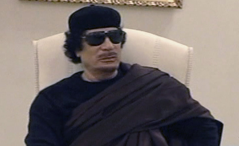 Libyan leader Moammar Gadhafi met in a Tripoli hotel Wednesday with tribal leaders from eastern Libya. The televised meeting marked his first public appearance since April 30 when NATO airstrikes hit his complex.