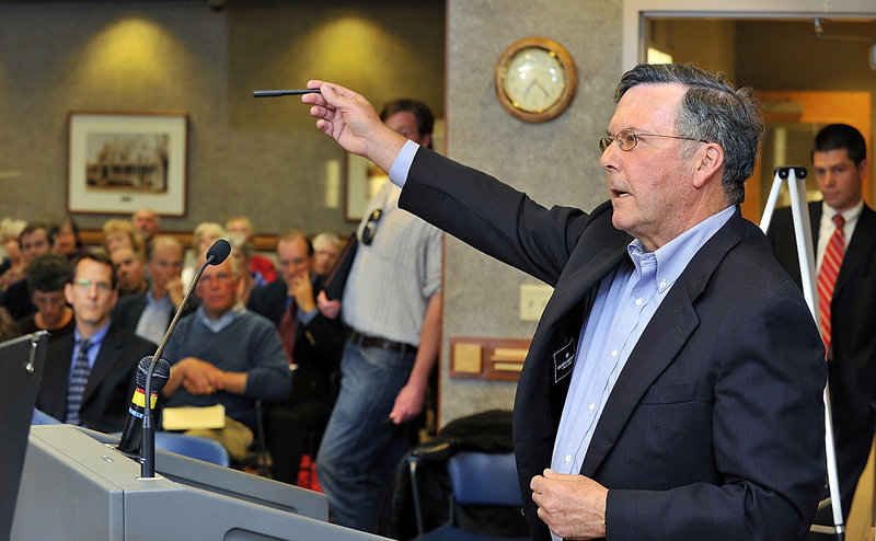 Peter Rubin, who lives near the site of the proposed oceanfront recreational facility in Scarborough, describes his opposition to the Sprague Corp. plan at a meeting of the town's Zoning Board of Appeals on Wednesday.