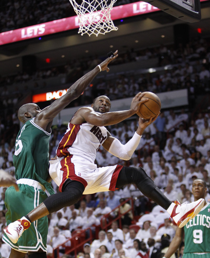 Dwyane Wade, who scored 34 points Wednesday night, drives ahead of Kevin Garnett of the Boston Celtics during the Miami Heat's 97-87 victory that ended the series.