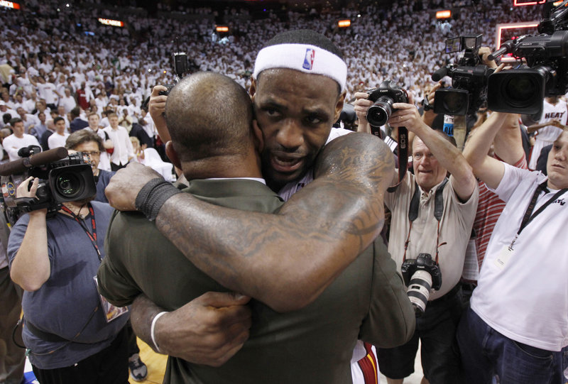 LeBron James hugs Celtics Coach Doc Rivers, who said after the loss Wednesday night that he plans to return next season.