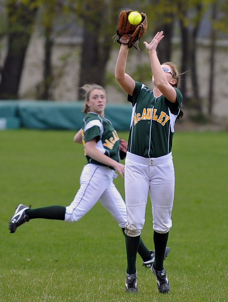 Top pic: Center fielder Shellby Bryant, right, of McAuley, makes a catch as left fielder Sam Libby backs up the play during Wednesday's game, a 4-3 McAuley win over Noble.