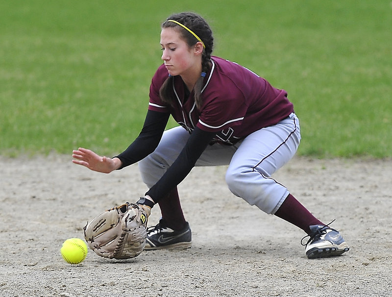 Nicole Lanoie of Noble stops a hard infield grounder during Wednesday's 4-3 loss to McAuley.