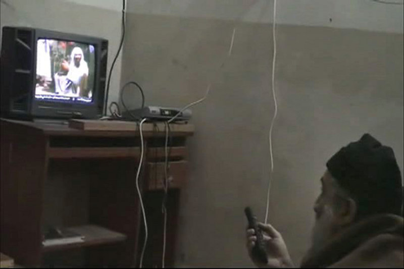 In this undated image from video seized from Osama bin Laden's compound in Abbottabad, Pakistan, a man who the U.S. government identified as bin Laden watches himself on television.