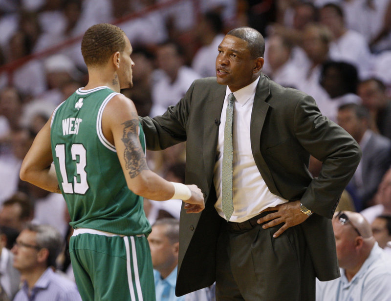 Doc Rivers, right, has been rumored for other jobs around the NBA, including with the Los Angeles Lakers. But he said he's a Boston Celtic and is leaning toward returning next season as coach for another run at a championship.