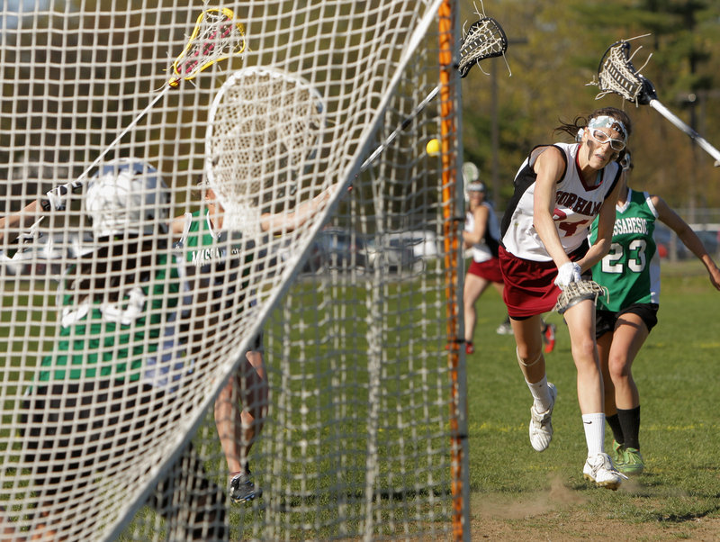 Mia Rapolla of Gorham takes aim on the net Thursday during the second half of a 15-11 victory against Massabesic in schoolgirl lacrosse. The shot went in for one of Rapolla's seven goals as the Rams remained undefeated.