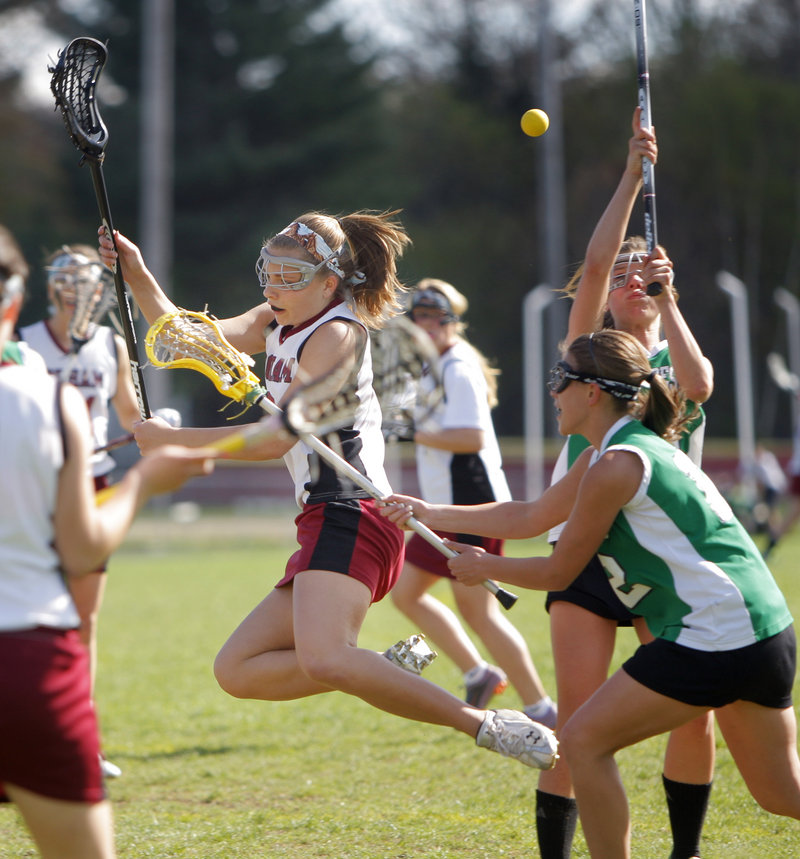 Kaitlyn SeeHusen of Gorham trips while trying to make her way through the Massabesic defenders. Gorham reached 8-0 while dropping Massabesic to 3-3.
