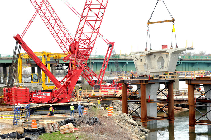 Employees of Reed & Reed Inc. work on Portland's new Veterans Memorial Bridge. The company employs about 200 people.