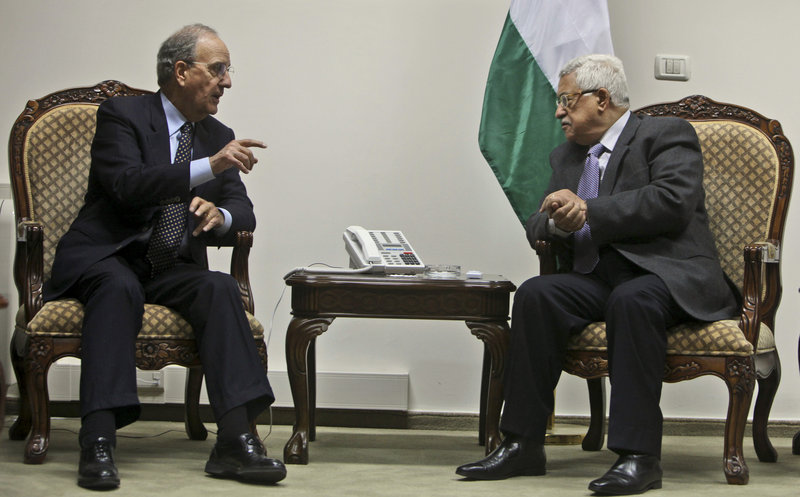 George Mitchell meets with Palestinian President Mahmoud Abbas at Abbas headquarters in the West Bank city of Ramallah in 2009 shortly after Mitchell was named Mideast envoy. He was seeking to prop up a Gaza cease-fire and restart broader peace talks.