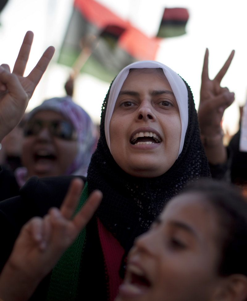 Women chant anti-Moammar Gadhafi slogans during a protest in Benghazi, Libya, on Friday. Gadhafi said in an audio recording played on Libyan TV that he is still alive despite NATO airstrikes.