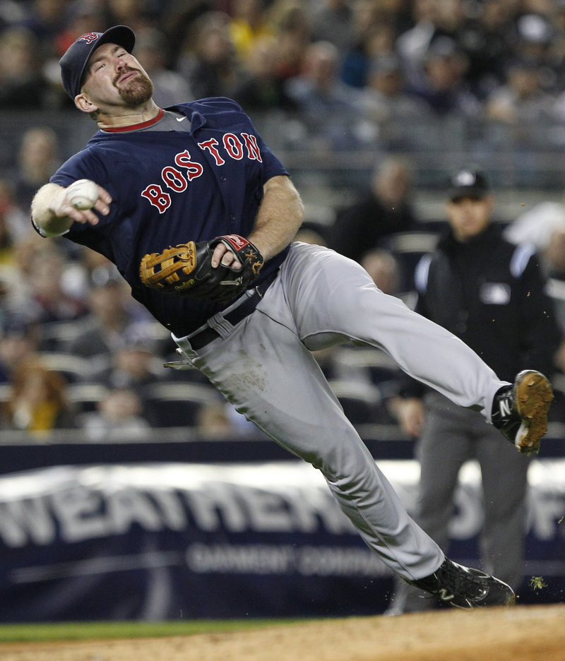 Kevin Youkilis of the Red Sox controls his body and whips a throw from third base in time to get Robinson Cano of the New York Yankees in the sixth inning of Boston's 5-4 victory Friday night.