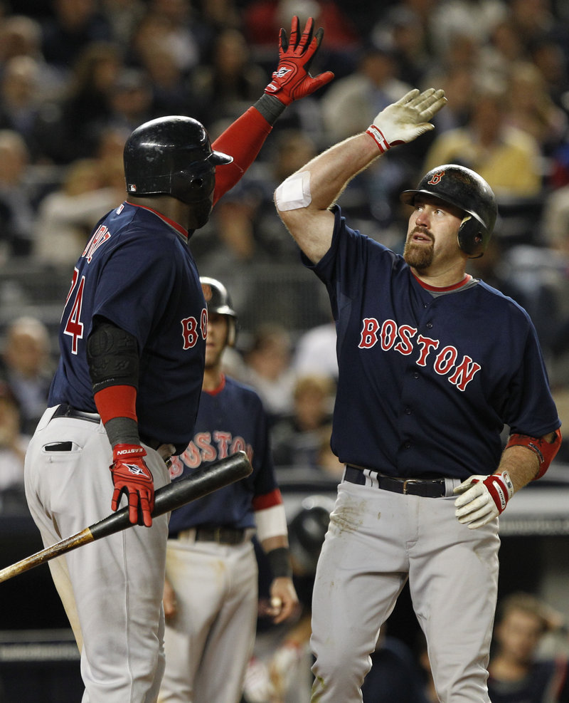 Kevin Youkilis, right, of the Red Sox celebrates with David Ortiz after hitting a two-run homer in the seventh inning Friday night en route to a 5-4 victory against the New York Yankees. Boston moved within two games of .500.