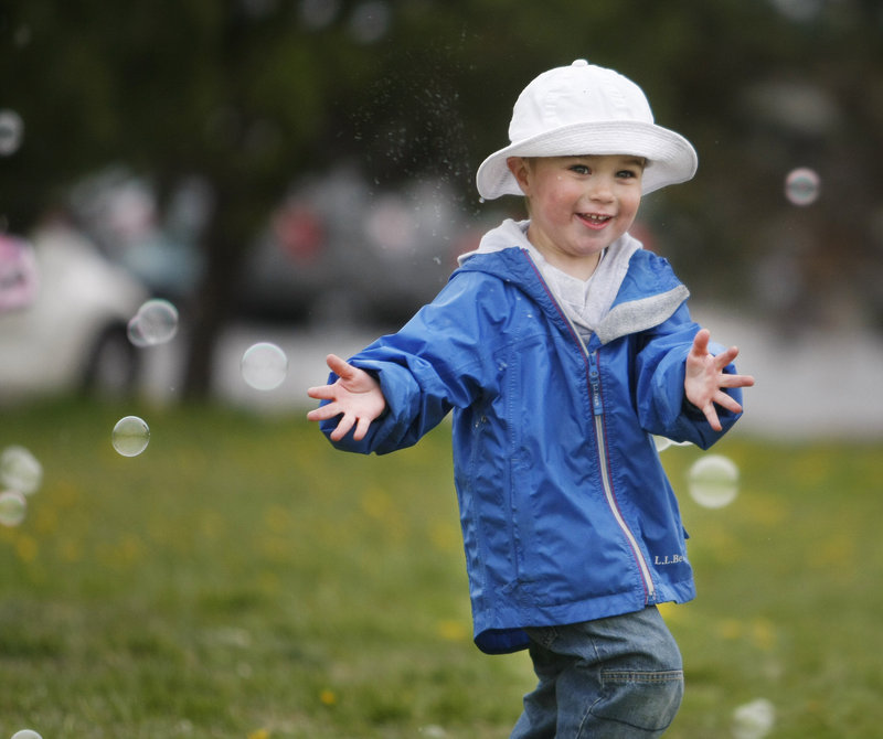 Paul Sames, 4, of South Portland has some fun chasing bubbles.