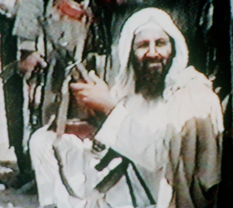 This grainy image shows Osama bin Laden holding an AK-47 assault rifle in an undated recruitment videotape for his organization dating back to at least 2001. The compound where he died was austere, lacking phones and the Internet.