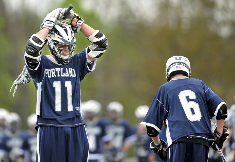 Caleb Kenney of Portland reacts Saturday after Messalonskee, which had trailed 4-0, took the lead in the third quarter en route to an 8-5 victory in lacrosse.
