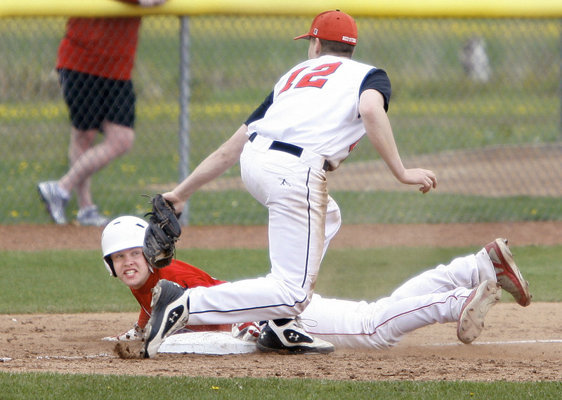 Ben Greenberg of Scarborough reaches back to tag out Jordan Muller of South Portland, who was attempting to steal third base Saturday in the fifth inning of South Portland's 5-0 victory in a Telegram League game.