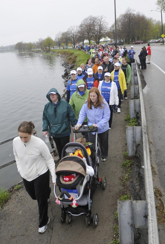 A light rain doesn't deter participants in the Southern Maine Heart Walk. About 4,000 Mainers died of heart disease in 2010.