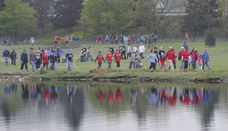 Participants in the 2011 Southern Maine Heart Walk go around Back Cove in Portland on Sunday. Depending on their condition, those taking part could walk one or four miles. Most of the funds raised will go toward research grants, said an American Heart Association spokeswoman.