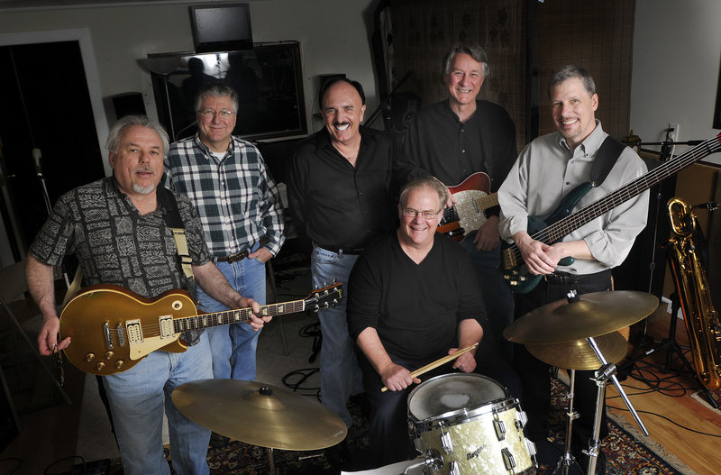 The All-Stars, from left, Mickey Gouzie, Brad Harnois, Rob Rocheleau, Steve Wark (seated), Tom Dyhrberg and Mike Wormwood, will play rock hits from their youth Saturday.