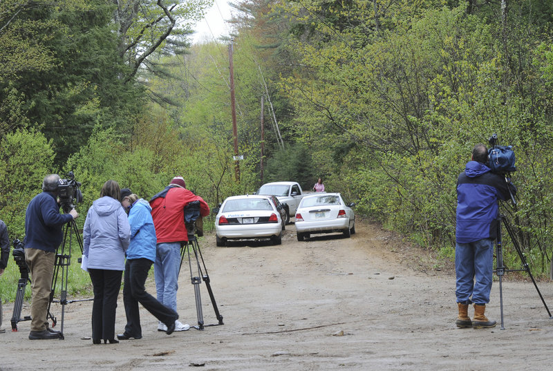 The news media gather at Dennett Road near the site where the body of a young boy was found Saturday evening in South Berwick. Police believe the boy was placed there around 7:30 a.m. Saturday, and he may have died only a few hours earlier.