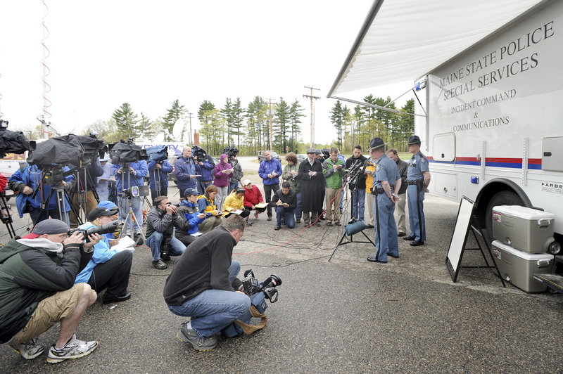 A large number of media representatives attend a news conference with Maine state police Col. Robert Williams and Lt. Bryan McDonough outside a mobile command post in Berwick on Monday. Police are seeking the public's help in identifying a boy whose body was found Saturday in South Berwick.