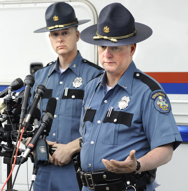 Col. Robert Williams, left, chief of the Maine State Police, and state police Lt. Brian McDonough give the media an update Monday afternoon outside a mobile command post in Berwick.