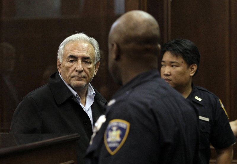 Dominique Strauss-Kahn, left, is remanded to custody after bail was denied at his arraignment Monday in Manhattan Criminal Court. He is accused of attacking a hotel maid who had gone in to clean his penthouse suite Saturday.