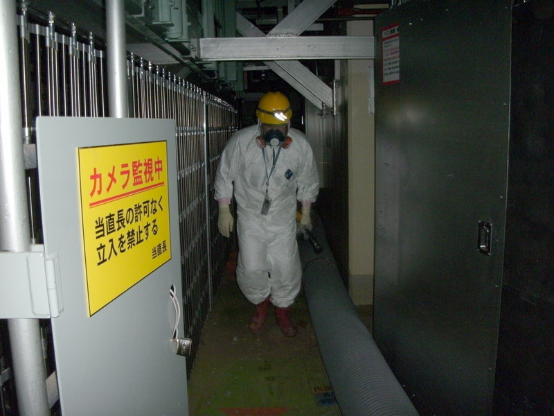 A worker walks on the first floor of the No. 1 reactor building at the Fukushima Dai-ichi nuclear power plant in Okuma, Fukushima Prefecture, northeastern Japan, early Monday.