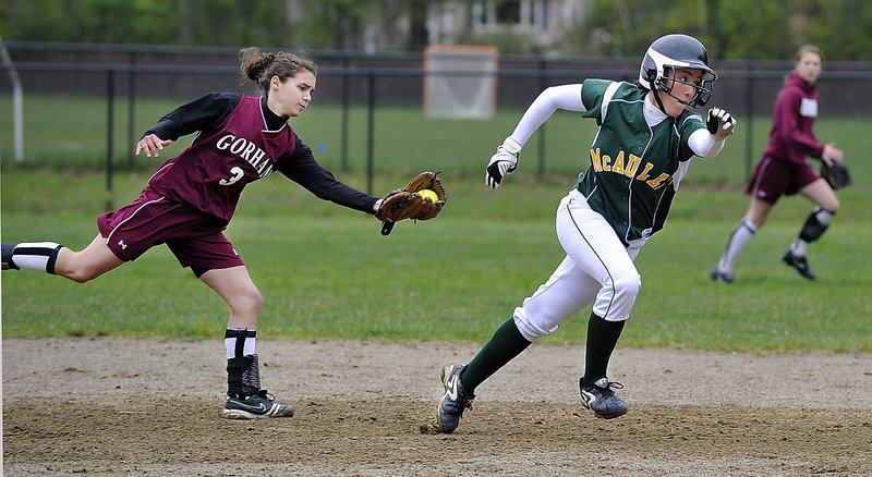 Kayla Daigle of McAuley races back to second base after Gorham shortstop Erin Smith caught a line drive. Daigle made it back safely.