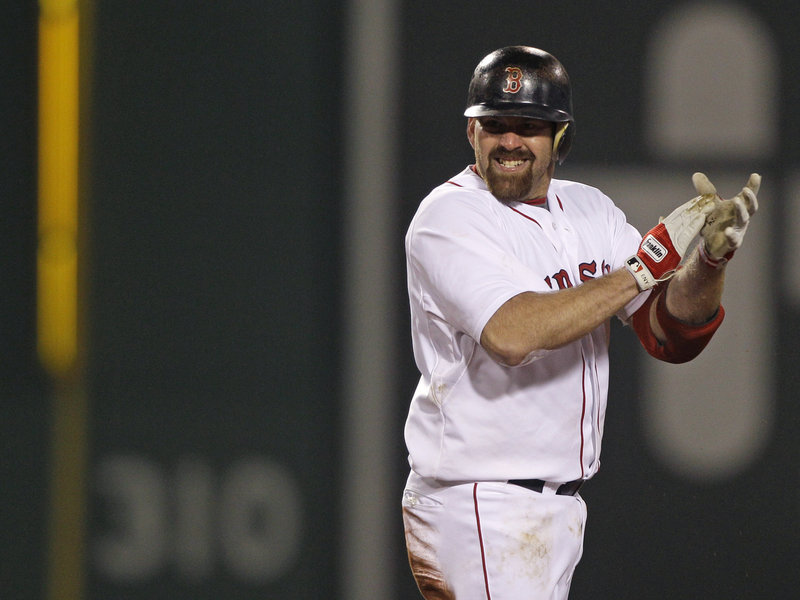 Kevin Youkilis celebrates after hitting a two-run double in the sixth inning Monday night against the Baltimore Orioles. The Red Sox overcame a shaky outing from Daisuke Matsuzaka and earned their fourth straight victory, moving into a tie for second place in the AL East.