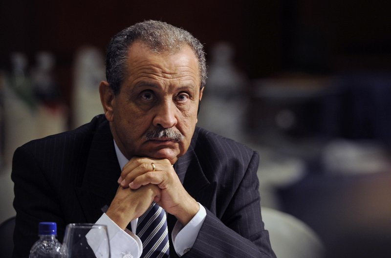 Shukri Ghanem, oil minister and head of the National Oil Co., joins the list of diplomats who have left Libya, as NATO widens its campaign of bombings and leafletting.