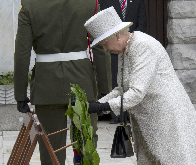 Britain's Queen Elizabeth II lays a wreath in the Garden of Remembrance in Dublin on Tuesday. The garden is dedicated to the memory of those who died in the struggle for Ireland's freedom from often harsh and repressive British rule. Northern Ireland remains part of the United Kingdom.