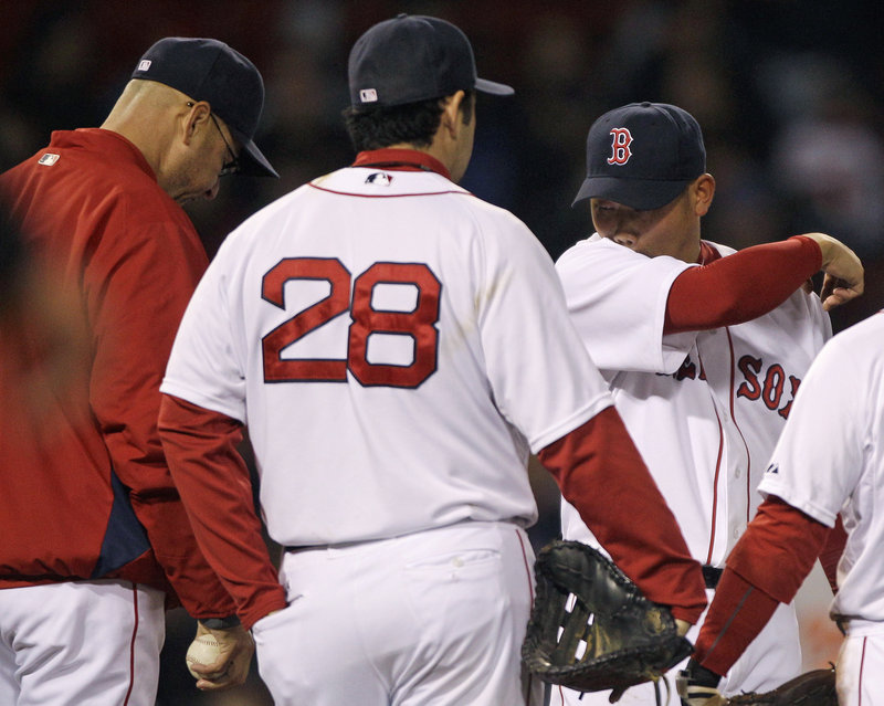 Daisuke Matsuzaka, right, will become the latest Red Sox pitcher to go on the disabled list. Manager Terry Francona said Dice-K has to rest a sore right elbow and will be replaced on the roster by Michael Bowden, up from Triple-A.