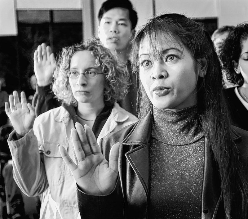 Asian immigrants like Chhouk Chhay of Portland, who took the oath of citizenship in 2003, are contributing to Maine.
