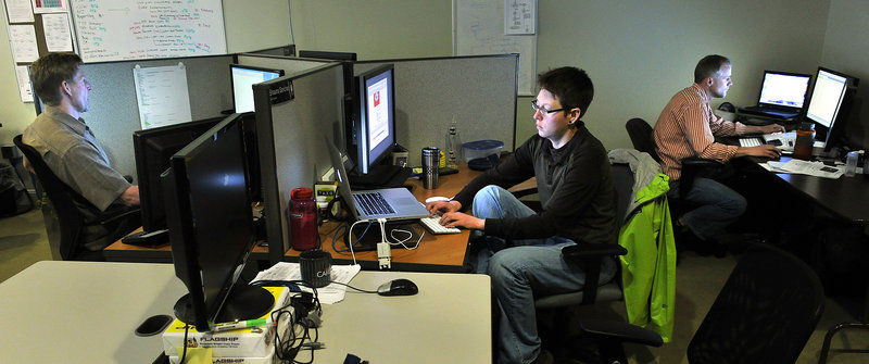 Computer engineers in CashStar Inc.'s engineering and design department work on new applications for the Portland firm, which manages digital gift card programs for a number of major retailers, including Home Depot.