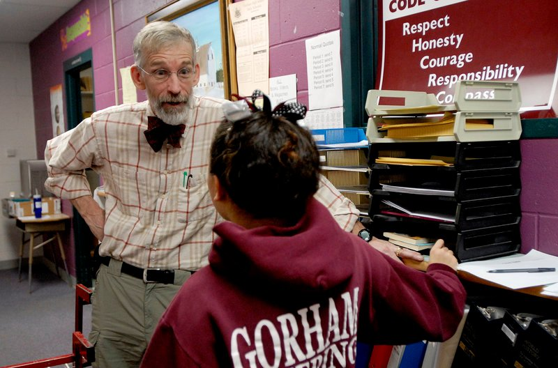 Bob Crowley, shown talking with a student at Gorham High School in 2008 when he was a teacher there, is the only Mainer to have won the $1 million prize on