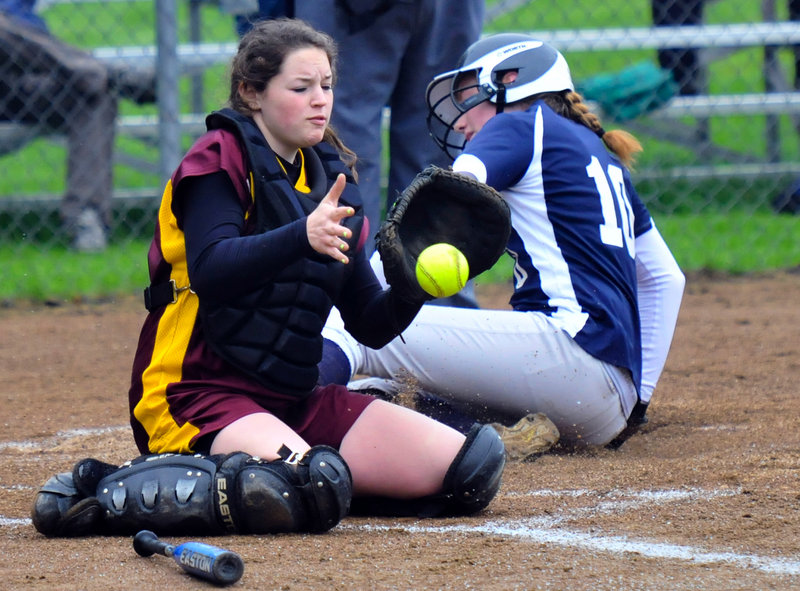 Abbie Hutchinson of Yarmouth finds the plate with a slide, scoring on a first-inning single by McKenzie Gray as Cape Elizabeth catcher Lauren Nicholson takes the throw Wednesday. Yarmouth beat the Capers for the second time in a week, 3-1.